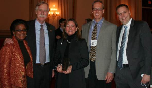 One of Preservation's Best, Elm Terrace historic rehabilitation in Portland, ME receives award at Congressional Reception. Pictured (left to right) Darlene Taylor,  Preservation Action; Senator Angus King (I-ME); Erin Cooperrider,  Community Housing of Maine; Cullen Ryan, Community Housing of Maine; Michael Phillips,  National Trust Community Investment Corporation