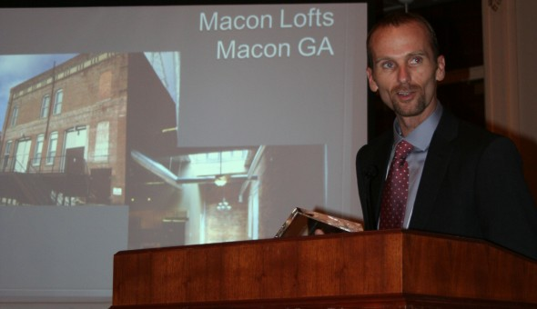 Bryan Nichols, developer of the Warehouse Lofts accepting his Preservation's Best award.